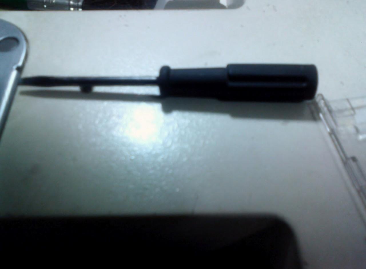 Chave de fenda para regular ponto de maquina de costura